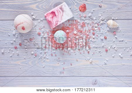 Spa and shower accessories. Bath bombs aromatherapy salthandmade soap bar and seashells on wooden background. Top view.