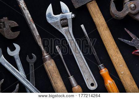 Construction Tools Set On Dark Background. Assortment Instruments For Repairman, Carpenter, Builder.