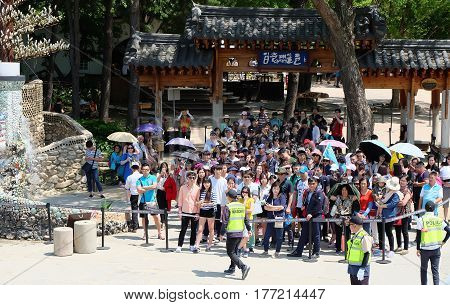 NAMI ISLAND, SOUTH KOREA -MAY 20: Hundreds of tourists waiting boat at port of Nami Island on May 20,2016 in South Korea.