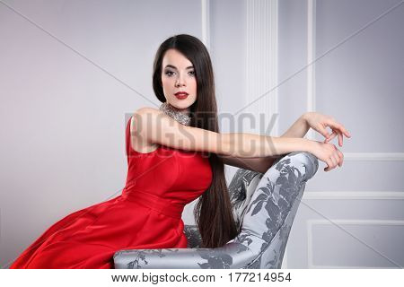beautiful young woman posing in studio