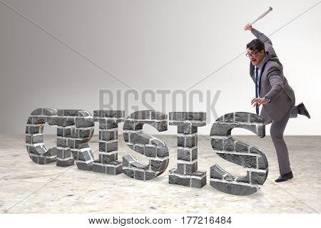 Angry man with baseball bat hitting crisis word