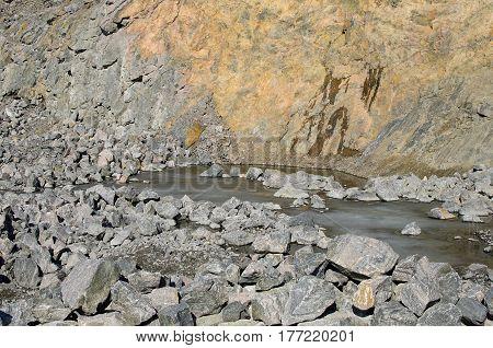 Granite quarry in sunny day. Quarry landscape