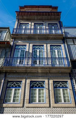 Townhouse frontage with ceramic tilework in Porto city Portugal