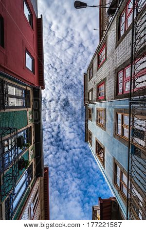 Town houses on a narrow street in Porto city Portugal