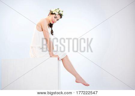 Woman In Dress On Cube