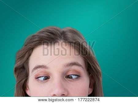 Digital composite of Funny eyes of woman against green background