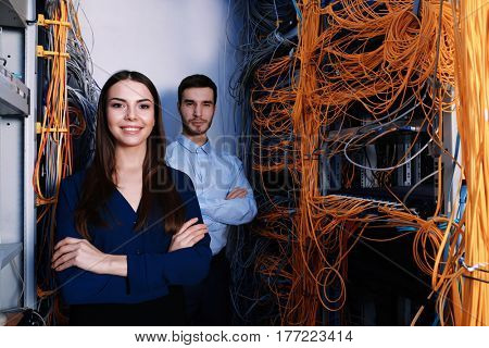 Young engineers in modern server room