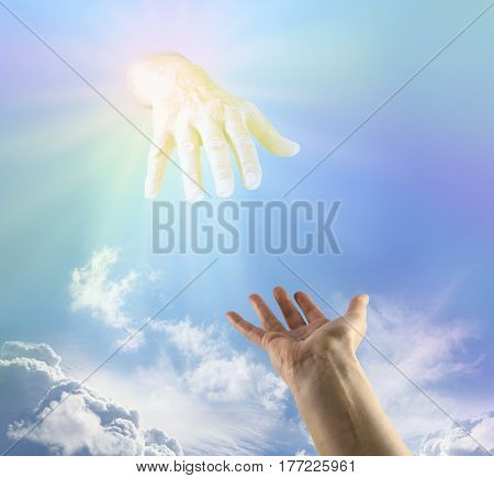 Asking for a Heavenly Helping Hand - female hand outstretched palm up reaching towards large golden flowing hand emerging from subtle rainbow colored light in the blue sky above depicting God