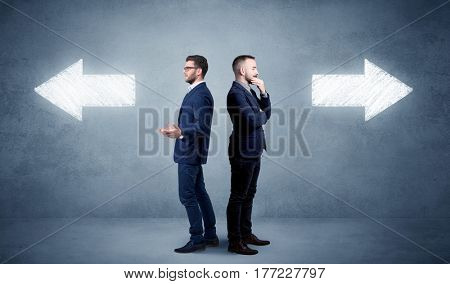 Young conflicted businessman choosing between two directions
