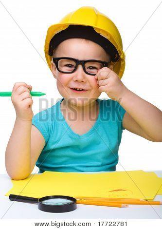 Cute Little Girl Draw With Marker Wearing Hard Hat