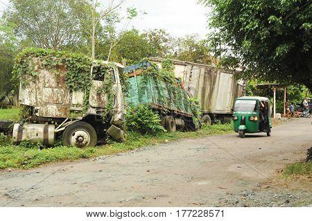 Quirigua, Guatemala - 24 January 2014: Abandoned truck wreck and train wagon at Quirigua on Guatemala