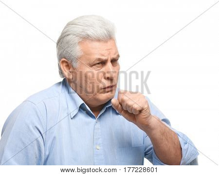 Mature man with allergy on white background