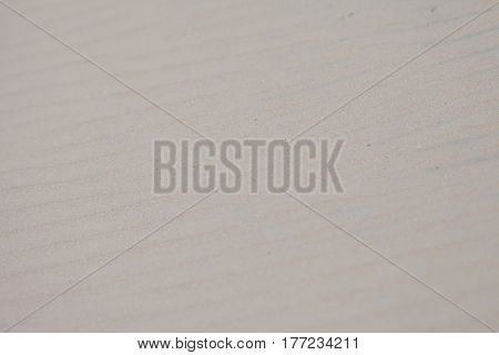 Light tan clean sand background with ripples