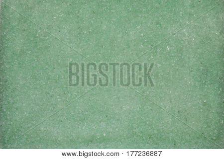 Background with mint green sea salt, closeup