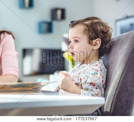Baby girl crying while eating