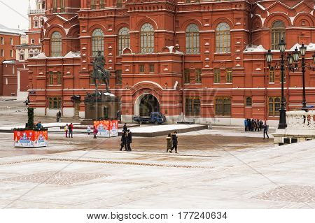 Moscow, Russia - February 1, 2017: Tourists on the Manege Square near the State Historical Museum in Moscow