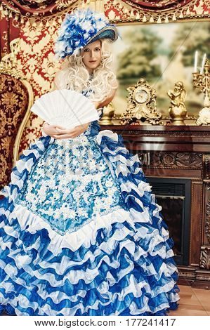 Beautiful woman wearing princess costume in luxury aristocratic interior