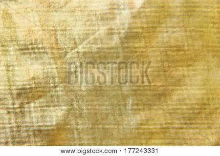 Gold texture of a tissue similar to foil