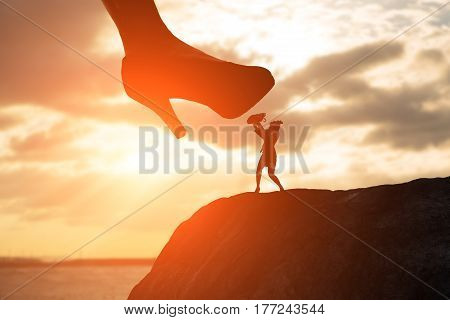 silhouette of fear businesswoman on the mountain