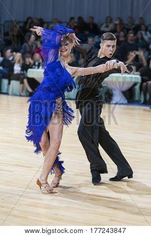 Minsk Belarus-February 18 2017: Couple of Danila Shmidt and Buldyk Arina Performs Youth Latin-American Program on WDSF Minsk Open Dance Festival-2017 Championship in February 18 2017 in Minsk Belarus.