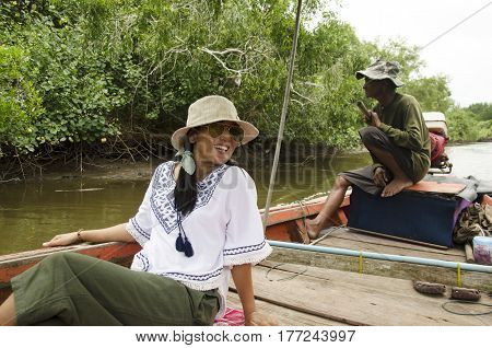 Thai Old Man Riding Long Tail Boat Bring People Travel Visit And Looking Riverbank And Mangroves For
