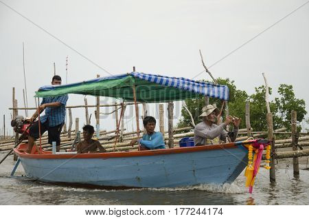 Thai Old Man Riding Long Tail Boat Bring People Go Home After Fishing In The Sea