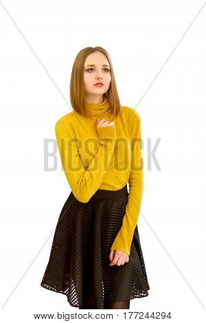 An image of a beautiful young girl in a yellow sweater and a black skirt