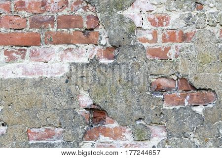 old brick wall partially plastered for backgrounds and compositions