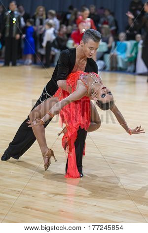 Minsk Belarus-February 18 2017: Unidentified Professional Dance Couple Performs Youth Latin-American Program on WDSF Minsk Open Dance Festival-2017 Championship in February 18 2017 in Minsk Belarus.