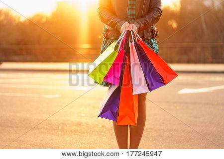 Woman holding her shopping bags in her hand - Let's go shopping concept