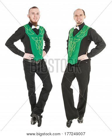 Two young man dancing irish dance isolated on white