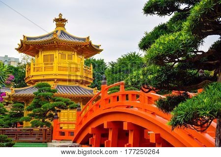 The oriental gold pavilion (pagoda) of absolute perfection in Nan Lian Chinese classical garden in Diamond hill Hong Kong