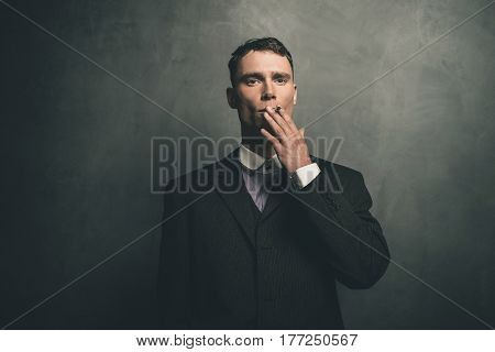 Retro 1920S English Gangster In Suit Smoking Cigarette.