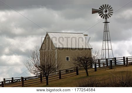 Farmhouse on a Cloudy Day with Windmill