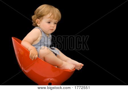 Girl In A Plastic Chair