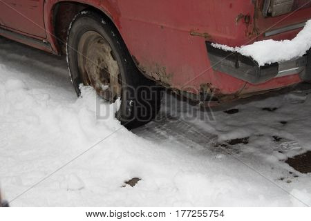 Rusty old Russian car standing on the snow