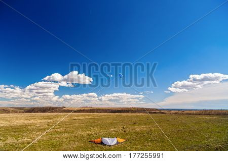 Picture With A Kite In The Sky With Clouds