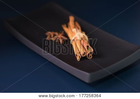 cinnamon sticks isolated on a black background.Selective focus.