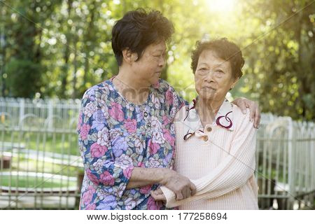 Candid shot of Asian elderly women at outdoor park in the morning.