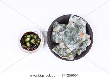 Steamed Dumpling Stuffed With Garlic Chives With Spicy Soy Source.