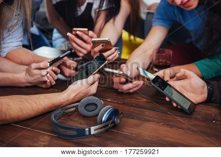 Top View Hands Circle Using Phone In Cafe - Multiracial Friends Mobile Addicted Interior Scene From