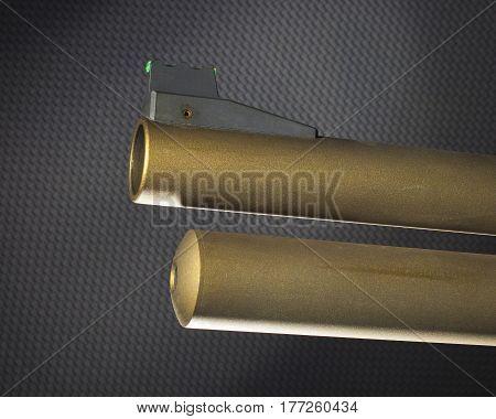 Gold colored shotgun barrel with fiber optic sight and tube magazine