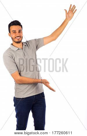 Young man introducing something isolated on white