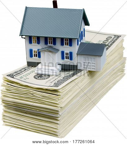 Model of a House on a Stack of Money - Isolated