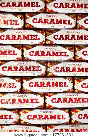 Southampton, UK - 17 March 2017: A background of Tunnock's Caramel Wafer biscuits, a popular chocolate coated snack.