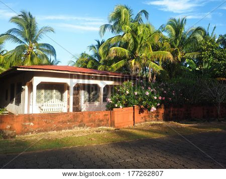 typical island house architecture with palm trees Big Corn Island Nicaragua Central America