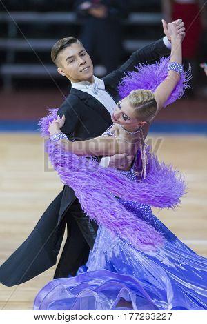 Minsk Belarus-February 182017:Couple of Danila Shmidt and Buldyk Arina Performs Youth Standard European Program on WDSF Minsk Open Dance Festival-2017 Championship in February 182017MinskBelarus.