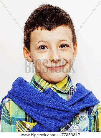 young pretty little cute boy kid wondering, posing emotional face isolated on white background, gesture happy smiling close up, lifestyle real people concept