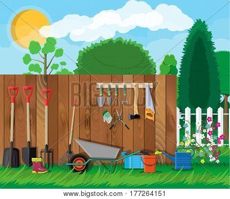 Gardening tools set. Equipment for garden. Saw bucket ax wheelbarrow hose rake can shovel secateurs gloves boots. Wooden fence, flower, grass, tree, sky, cloud. Vector illustration in flat style