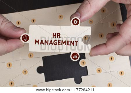Business, Technology, Internet And Network Concept. Young Businessman Shows The Word: Hr Management